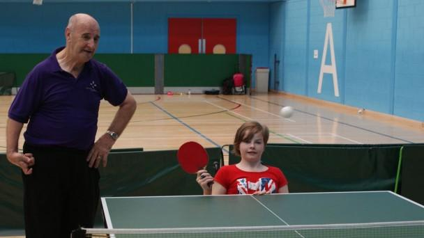 Children learning to play Table Tennis