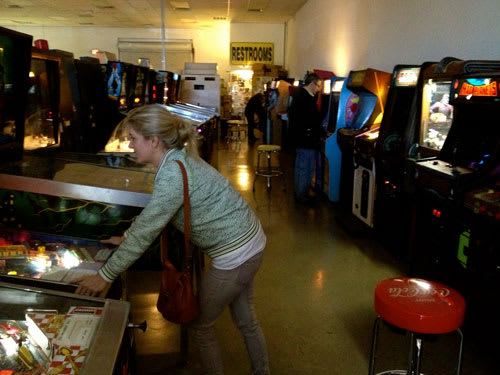 Michelle Playing Pinball at Pinball Hall of Fame